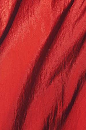 detail of orange fabric curtain