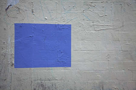 rectangle: cinderblock wall with blue rectangle Stock Photo