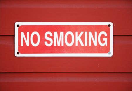 no smoking sign mounted on wall Stock Photo