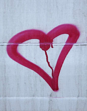 deface: heart painted on side of train car