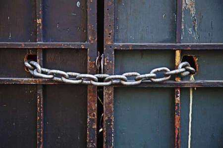 chain keeping wooden doors locked