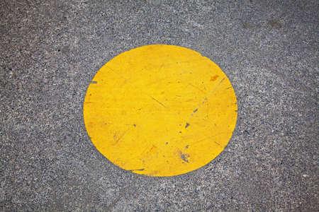 yellow circle painted on park walkway
