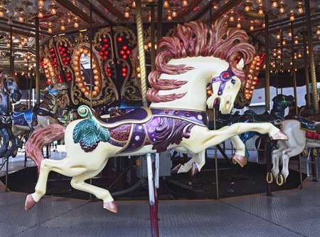 detail of carousel featuring horse photo