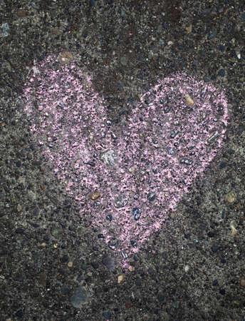 pink chalk heart of sidewalk