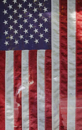 american flag hanging in shop window Stock Photo