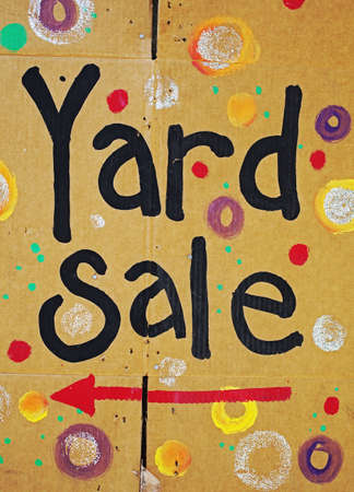 brightly colored yard sale sign Stock Photo