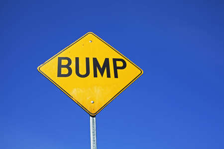 bump sign mounted next to street