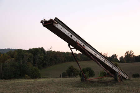 farm equipment: Old farm equipment during the evening
