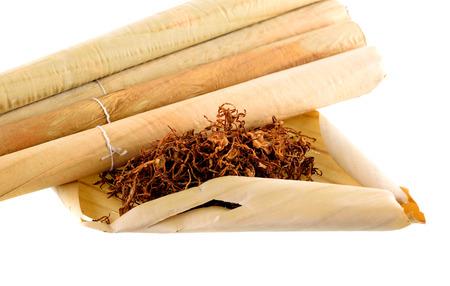 Tobacco and cigarette on white background