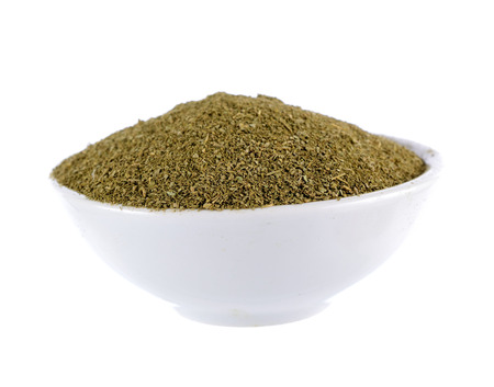 Dried Moringa powder in the bowl on white background