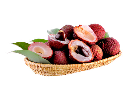 Lychees in the basket on white background Stock Photo