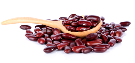 red beans  in a spoon on the white background