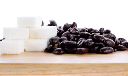 coffee beans  and white sugar isolated on wooden table