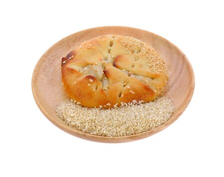 Traditional bread in wooden plate isolated on white background Фото со стока