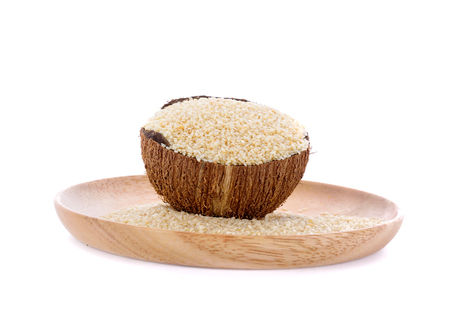 White sesame in wood bowl and wood plate onwhite background