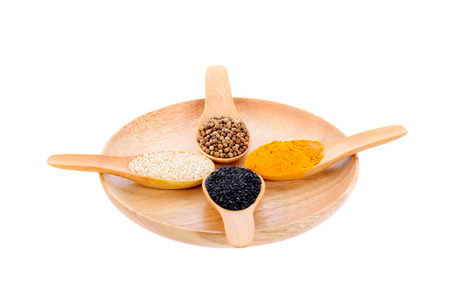 Cereal grains , seeds, beans in spoons on wooden plate