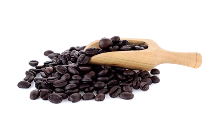 Fresh coffee beans in  wooden scoop  isolated on white background