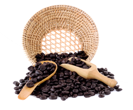 Fresh coffee beans in basket  with wooden scoop  and wooden spoon  isolated on white background