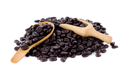 Fresh coffee beans in  wooden scoop and wooden spoon  isolated on white background