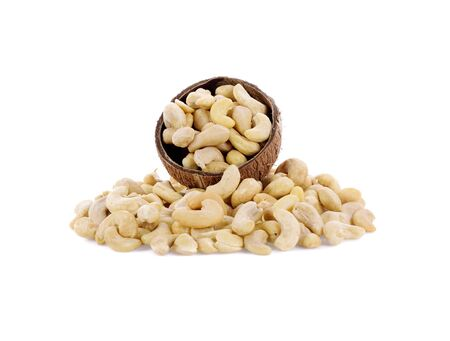 Cashews in wooden bowl  isolated on white background Фото со стока