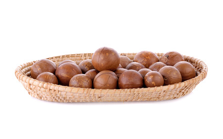 macadamia nuts in basket isolated on white background