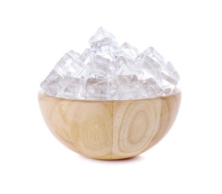 ice cubes in wooden  bowl isolated on white background