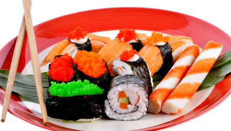 Sushi set with chopsticks  in  plate isolated  on white background Фото со стока