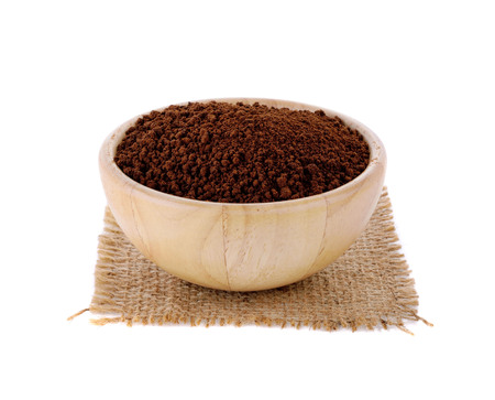 instant coffee in wooden basket on white background