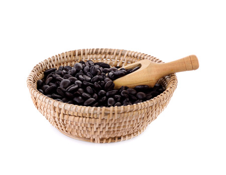 Fresh coffee beans in basket with wooden scoop  isolated on white background