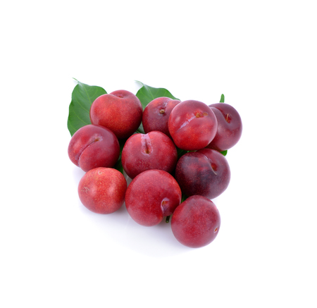 Red plums isolated on white background