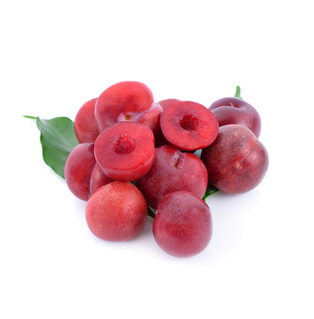 Close up of red plums isolated on white background