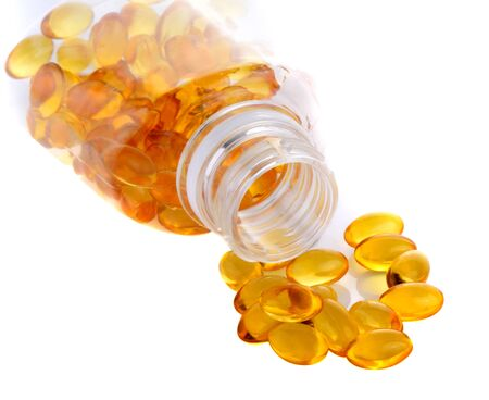 Fish oil capsules in bottle isolated on white background