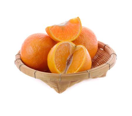 sweet ripe orange Isolated in bamboo basket