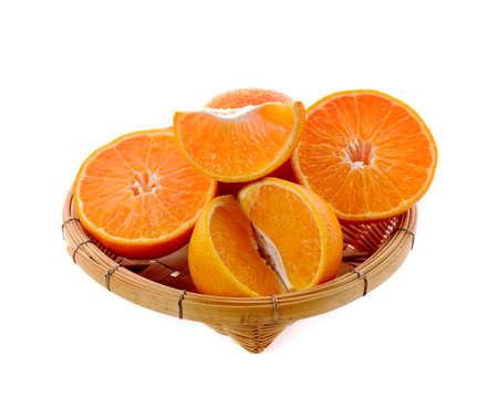 sweet ripe orange slices Isolated on bamboo basket