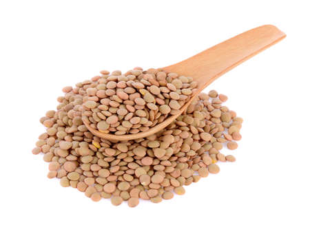 lentils in wooden spoon isolated on white background