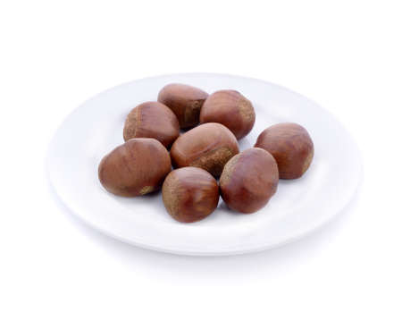 chestnuts  in white plate isolated on white background