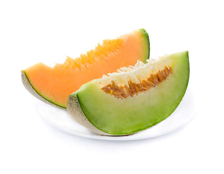 melon slices in white plate isolated on white background