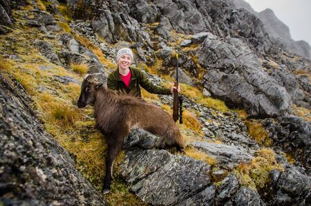 young woman hunter with tahr