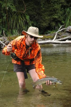 trout fisherman with fish 版權商用圖片