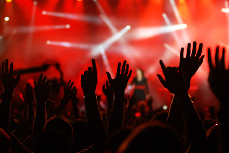 raised hands at rock concert Stockfoto