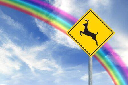 Deer sign on rainbow sky photo