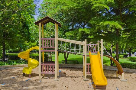 school playground: playground in a city park.
