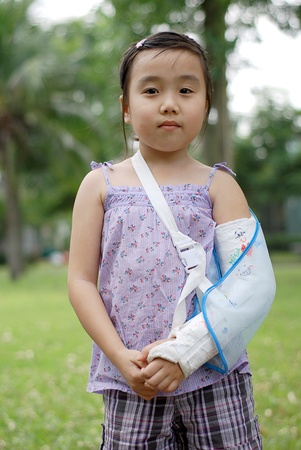 broken wrist: little girl with broken arm Stock Photo
