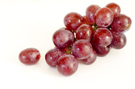 grape fruit: Close up of red grapes on white background