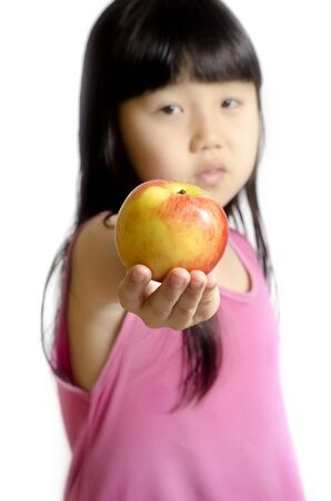 isoleted: Beautiful little girl with apple soft fous isoleted on white Stock Photo