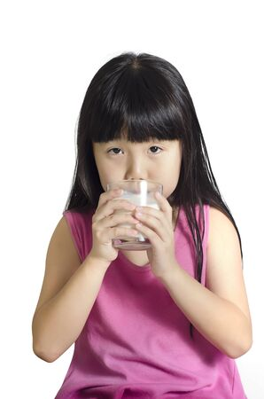 Cute little girl drinks milk, isolated over white Stock Photo - 10798201