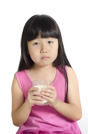 Portrait of a little girl holding a cup of milk, isolated on white Stock Photo - 10798214