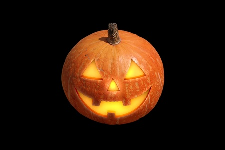 carved pumpkin: Scary halloween pumpkin jack-o-lantern candle lit, isolated on black background Stock Photo