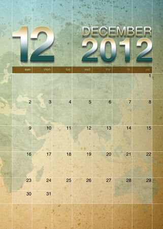 December 2012 calendar on World map background Stock Photo - 10901764