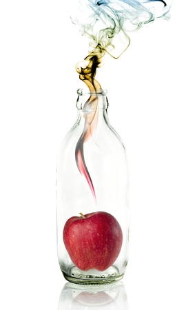 apple in Glass bottle with concept smoke Stock Photo